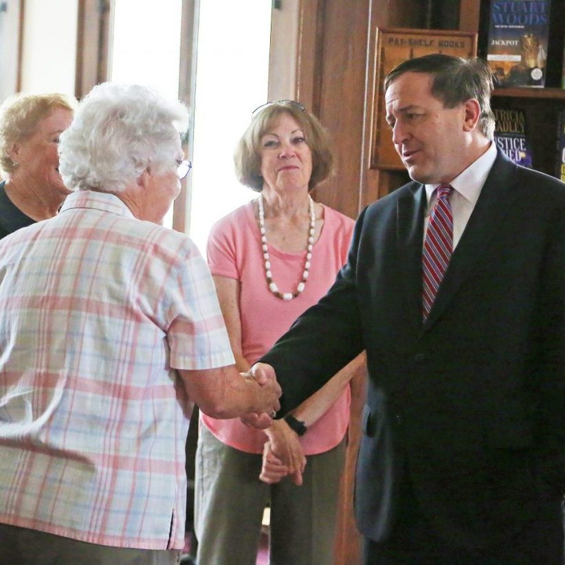 Missouri Secretary of State Jay Ashcroft visited the Shelbina Carnegie Library on Wednesday, August 25. He is pictured above shaking Shelby County Historical Museum President Kathleen Wilham's hand during his 30 minute visit and tour of the library. Photograph by Marlana Smith
