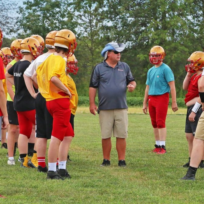 Head Coach David Stuckey began his first season at North Shelby on Friday, August 27 when the Raiders traveled to Maysville. He is shown above during the Raiders practice Thursday, August 26. Photograph by Marlana Smith